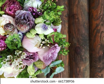Rustic flowers on dark wooden background. Flower set of rustic flowers. Purple rustic flowers set. flowers for rustic wedding bouquet