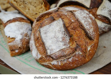 Rustic French sourdough bread boule with slashes on top of the crust