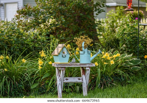 Fantastic Rustic Garden Bench Blue Birdhouse Watering Stock Photo Ncnpc Chair Design For Home Ncnpcorg