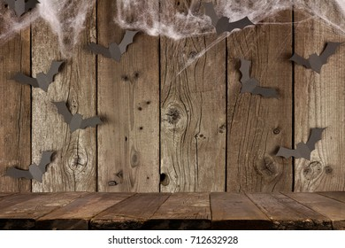 Rustic Halloween Old Wood Plank Background With Spiderwebs And Bats