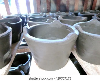 Rustic handmade ceramic clay brown terracotta cups souvenirs at street handicraft market/ Angtong, Thailand
