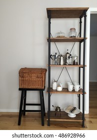 Rustic industrial shelving unit used as a coffee bar