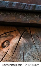 Rustic industrial textures of wood and steel.  Custom steel anvil set into weathered madrone stump with a forged billet of high carbon steel on top