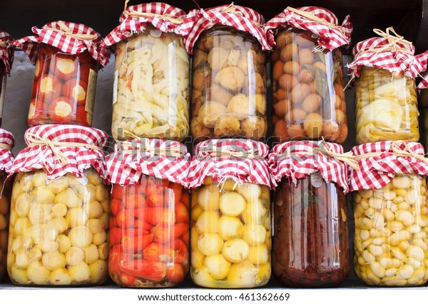 Rustic jars with home-made pickles of different kinds. Simple, tasty and colorful.