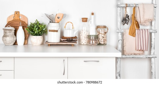 Rustic kitchen bench and ladder with various utensils on white