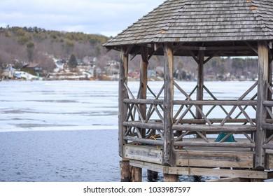 A rustic lakeside gazebo structure on Lake Winnipesaukee in New Hamsphire.