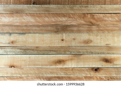 Rustic light brown wooden background. Wood textured surface made with Pine and Eucalyptus boards and slats.