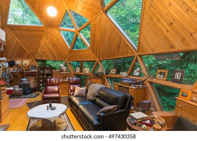 The rustic living room of an energy efficient custom-designed geodesic dome house.