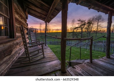 Rustic log cabin, front porch and sunset, Cumberland Gap Natl Park
