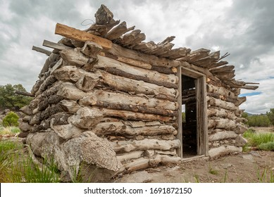 A rustic log cabin made from rough beams that never went through a proper sawmill. Cave Valley, White Pine Couty, Nevada, USA.