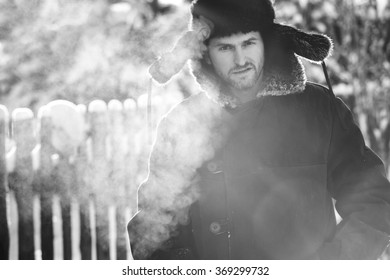 Rustic man in old clothes in the cold winter. Black, White portrait