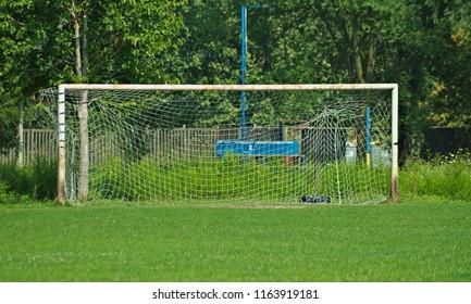 Rustic metal goal gate on football field