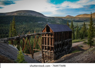 a rustic mine building in the mountains of colorado