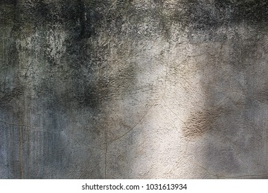 Rustic moldy cement wall with rough texture