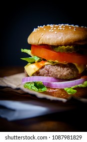 Rustic moody cheeseburger with sesame seed bun