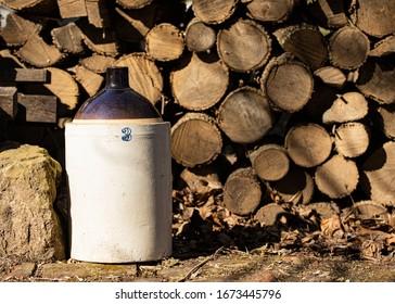 Rustic Moonshine Jug with Woodpile