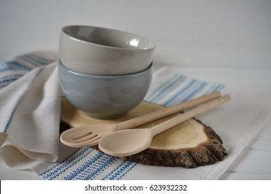Rustic napkin and kitchen tools. Plate on a wooden stand. Set of Porcelain Dishes. Kitchen Utensil