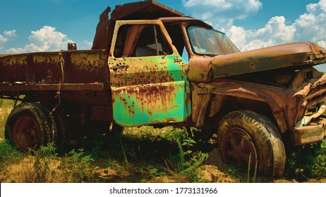 Rustic old chevy farm truck with green door used as target practice on an abandon farm near westover maryland somerset county