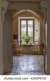 rustic old house, looking through doorway to kitchen and garden beyond