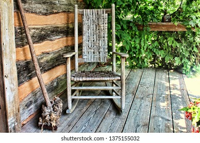 Rustic old rocking chair on front porch of a cabin