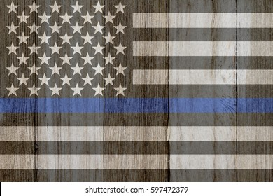A rustic old thin blue line flag on weathered wood for a background