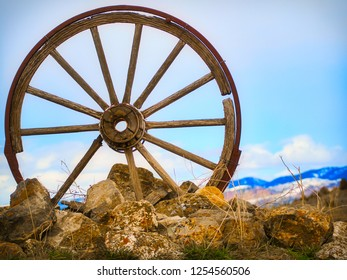 Rustic Old Vintage Antique Wood Steel Wagon Wheel in a Mountain Landscape
