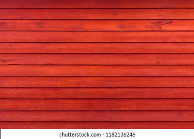 Rustic Old Weathered Red Wood Plank Background extreme closeup
