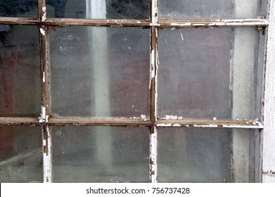 rustic old window frame and glass with peeling paint