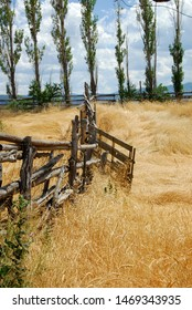 A rustic old wooden fence cuts through the southwestern country side. Fine art landscape photography.