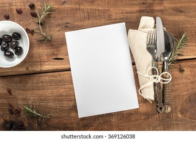 Rustic Old Wooden Mediterranean Table Top With White Menu Paper
