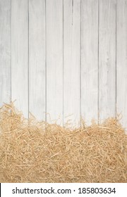 Rustic Painted Gray or White Wood Board Background with Straw Banner on Side for a Farm or Barn Effect.  Empty Room or space for copy, text.  Vertical