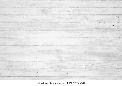 Rustic painted wood wall or floor. Rough wooden planks. Peeling white paint with light neutral flat faded tones.