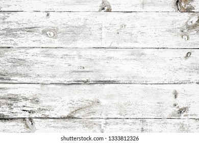 Rustic painted wood wall or floor. Rough wooden planks. Peeling white paint with light neutral flat faded tones