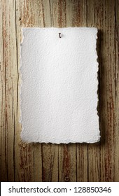 rustic paper sheet on aged wooden wall