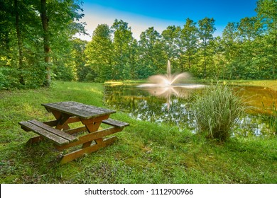 Rustic Picnic Table next to a Pond