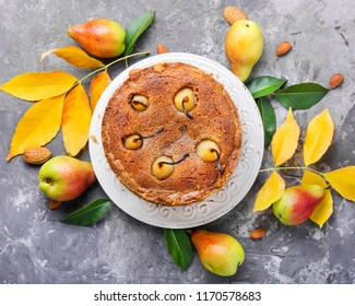 Rustic pie with pears and fallen autumn foliage. Autumn kitchen.