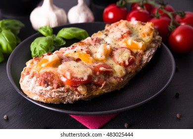 Rustic pizza sandwich with tomatoes and paprika