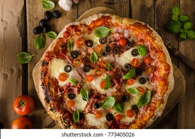 Rustic pizza with tomato, cheese, salami simple fast meal