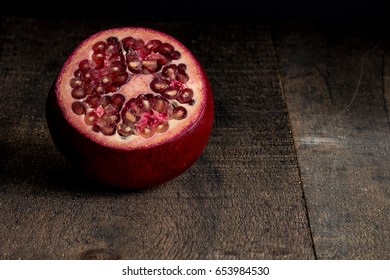 Rustic pomegranate on wood background