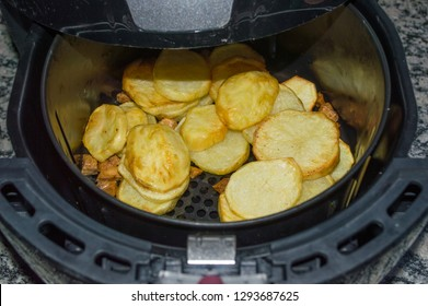 rustic potato chips homemade French fries, being prepared in an oil-free fryer, Fryer without oil