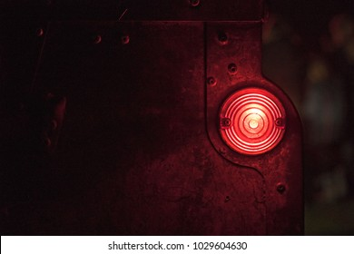 Rustic round red light in the darkness.