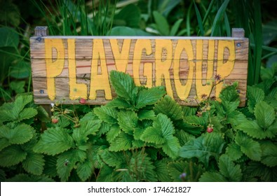 Rustic Sign In The Garden Of A Rural School Playgroup