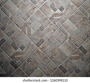 Rustic stone floor with different size and shapes tiles. Top view