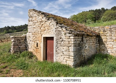 A rustic stone shed stands in a corner of a vineyard near the town of Gevrey-Chambertin in the Burgundy region of France.