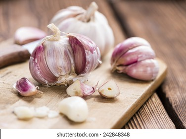 Rustic style Garlic (peeled) on vintage wooden background