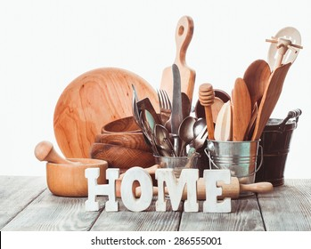 Rustic style kitchen - wooden and retro untersils and HOME letters