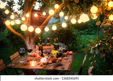Rustic table with appetizers and wine in the evening