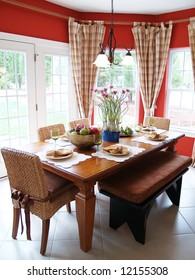 A rustic table set for a meal in a bright breakfast room