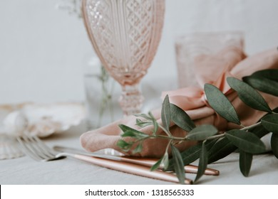 Rustic table settings pastel tones. Olive branch