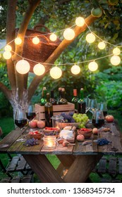 Rustic table with snacks and wine in the evening